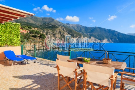 stock-photo-chairs-with-table-on-sunny-terrace-with-sea-view-on-kefalonia-island-near-assos-village-greece-224222548
