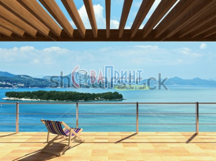 stock-photo-large-terrace-with-loungers-and-beautiful-sea-views-241101745