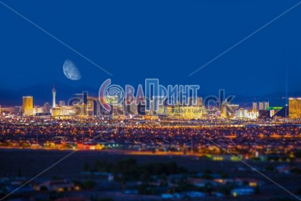 stock-photo-las-vegas-strip-and-the-moon-las-vegas-panorama-at-night-nevada-united-states-221463787