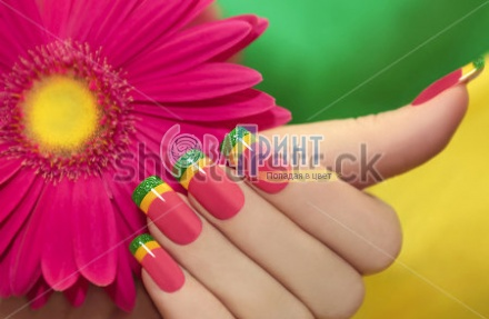 stock-photo-multicolored-manicure-with-pink-yellow-and-green-lacquer-against-the-background-with-gerbera