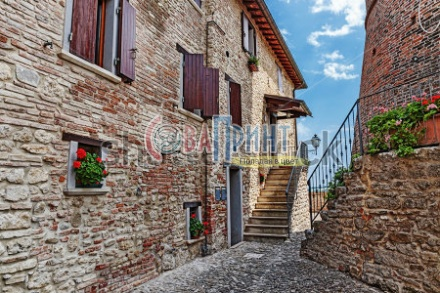 stock-photo-old-cobbled-street-in-italy-234093658