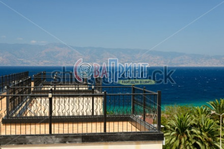stock-photo-roof-terrace-with-great-panoramic-view-of-sicily-and-strait-of-messina-153676244