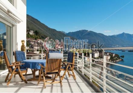 stock-photo-terrace-of-a-penthouse-blue-table-with-chairs-222977458