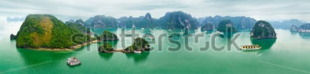 stock-photo-tourist-junks-floating-among-limestone-rocks-at-early-morning-in-ha-long-bay-south-china-sea-17