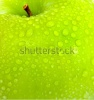 stock-photo-apple-in-green-with-water-drops-on-its-surface-57965215