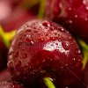 stock-photo-background-from-sweet-fresh-wet-red-cherry-macro-image-154608932