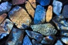 stock-photo-beautiful-texture-of-natural-wet-colorful-labradorite-gem-stones-144707182
