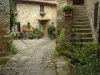 stock-photo--cute-courtyard-in-montefioralle-village-sometimes-claimed-to-be-the-birthplace-of-amerigo-38058094