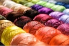 stock-photo-different-color-threads-on-rows-in-the-store-73219969
