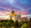 stock-photo-fairy-palace-against-sunset-sky-panorama-of-pena-national-palace-in-sintra-portugal-europe-144418426