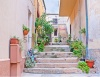 stock-photo-la-maddalena-italy-september-the-tiny-courtyard-and-the-staircase-decorated-with-2137585