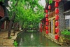 stock-photo-photo-of-beautiful-street-in-lijiang-china-with-a-canal-old-houses-trees-and-red-lantern