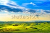 stock-photo-tuscany-rural-sunset-landscape-countryside-farm-cypresses-trees-green-field-sun-light-and-22287