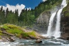 waterfalls_stock-photo-alpine-waterfall-in-mountain-forest-under-blue-sky-74748757
