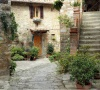 stock-photo-beautiful-courtyard-in-tuscan-medieval-village-montefioralle-near-greve-in-chianti-sometimes-8868035