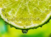 stock-photo-close-up-of-a-lemon-slice-with-bubbles-65856742